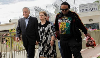 An archive photo from April 2015 showing ex-President Moshe Katsav leaving prison for a Passover furlough.