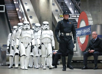 Star Wars fans dressed as stormtroopers descend on the London underground's Canary Wharf station, December 15, 2016.