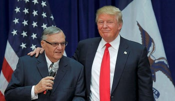 U.S. Republican presidential candidate Donald Trump is joined onstage by Maricopa County Sheriff Joe Arpaio (L) at a campaign rally in Marshalltown, Iowa January 26, 2016