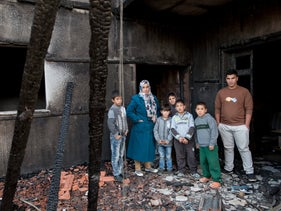 Members of the Dawabsheh family where their kin were killed by a firebomb, Duma, West Bank, December 3, 2015.
