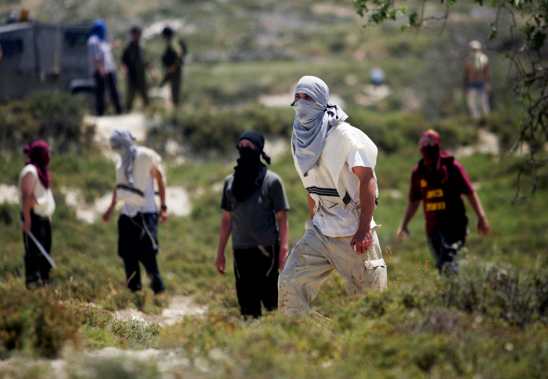 Jewish settlers throw rocks at Palestinians during clashes near the Jewish settlement of Yitzhar.