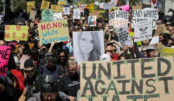 People march as part of a counter protest to a cancelled right-wing rally in San Francisco, California on August 26, 2017.