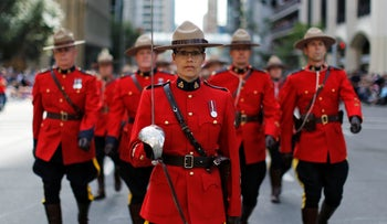 Members of the Royal Canadian Mounted Police march during the Calgary Stampede parade in Calgary, Alberta, Canada July 8, 2016.