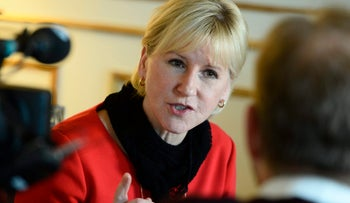 In this Wednesday, March 11, 2015 file photo, Swedish Foreign Minister Margot Wallstrom gestures during a media interview at the Ministry of Foreign Affairs in central Stockholm, Sweden.