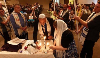 Nicholas Thalasinos and his wife renew their marital vows at a Jewish-style ceremony in 2013.