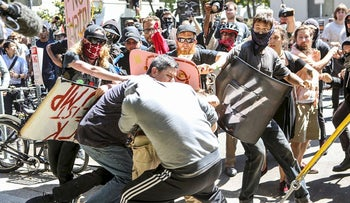 No-To-Marxism rally members and counter protesters clash on August 27, 2017 at Martin Luther King Park Jr. Civic Center Park in Berkeley, California