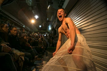A dancer performs at the 'Jaffa to Agripas' event in Jerusalem's Mahane Yehuda market on December 3, 2015.