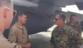 Renken (C), the U.S. Air Force pilot who shot down an Iranian-made drone over Syria on June 8, 2017