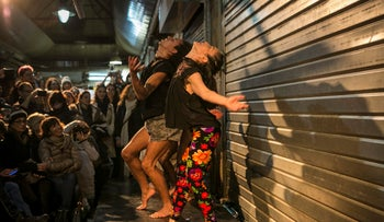Women dance at the 'From Jaffa to Agripas' event in Jerusalem's Mahane Yehuda market on December 3, 2015.