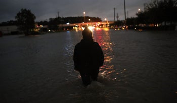 HOUSTON, TX - AUGUST 29: A Houston resident walks through waist deep water while evacuating her home after severe flooding following Hurricane Harvey in north Houston August 29, 2017 in Houston, Texas. Harvey, which made landfall north of Corpus Christi late Friday evening, is expected to dump upwards of 40 inches of rain over the next couple of days.   Win McNamee/Getty Images/AFP == FOR NEWSPAPERS, INTERNET, TELCOS & TELEVISION USE ONLY ==