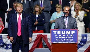 Nigel Farage speaks as Republican presidential candidate Donald Trump listens, at a campaign rally in Jackson, Miss., August 24, 2016.
