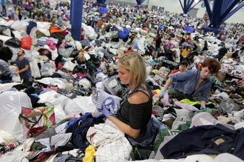 Donated items sit in a loading dock are as volunteers works to organize the items donated for Hurricane Harvey victims, Tuesday, Aug. 29, 2017, in Dallas, Texas. (AP Photo/Tony Gutierrez)