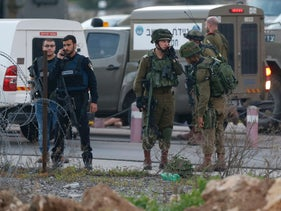 Israeli forces monitor the an area near the Beit El settlement close to Ramallah after an attempted stabbing attack, February 26, 2016.