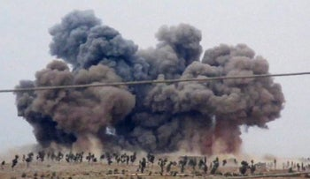 In this image made from video provided by Hadi Al-Abdallah, which has been verified and is consistent with other AP reporting, smoke rises after airstrikes in Kafr Nabel of the Idlib province, western Syria, Thursday, Oct. 1, 2015. Russian jets carried out a second day of airstrikes in Syria Thursday, but there were conflicting claims about whether they were targeting Islamic State and al-Qaeda militants or trying to shore up the defenses of President Bashar Assad.