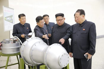 North Korean leader Kim Jong Un purportedly offering guidance for his nuclear weapons program. Photo released by North Korea's Korean Central News Agency in Pyongyang, September 3, 2017