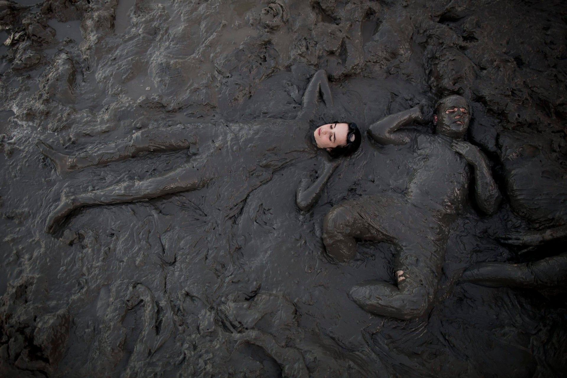 Ultra-Orthodox men covering themselves in mud during the Bein Hazemanim (literally, between the sessions - the Yeshivot vacation period) on one of the shores of the Dead Sea, designated exclusively to men. The Dead Sea mud is rich in diverse minerals and is considered to have numerous medical virtues.  The Dead Sea, 16 August 2016