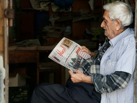 A man reads an Arabic newspaper - only 2.5 percent of Israeli Jews can read one, a new study finds.