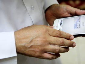 "Human rights activist Ahmed Mansoor shows Associated Press journalists a screenshot of a spoof text message he received in Ajman, United Arab Emirates, on Thursday, Aug. 25, 2016. Mansoor was recently targeted by spyware that can hack into Apple's iPhone handset. The company said Thursday it was updated its security. The text message reads: ""New secrets on the torture of Emirati citizens in jail."""