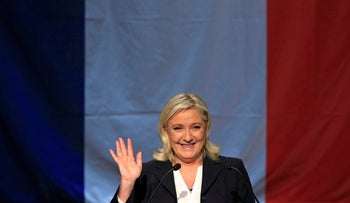 French National Front leader Marine Le Pen delivers her speech after the announcement of the results during the first round of the regional elections in Henin-Beaumont, France, December 6, 2015.