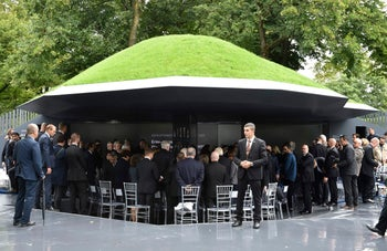 """Guests stand inside """"The Munich 1972 Massacre Memorial"""" dedicated to the 1972 Olympic attack in Munich, Germany, September 6, 2017."""