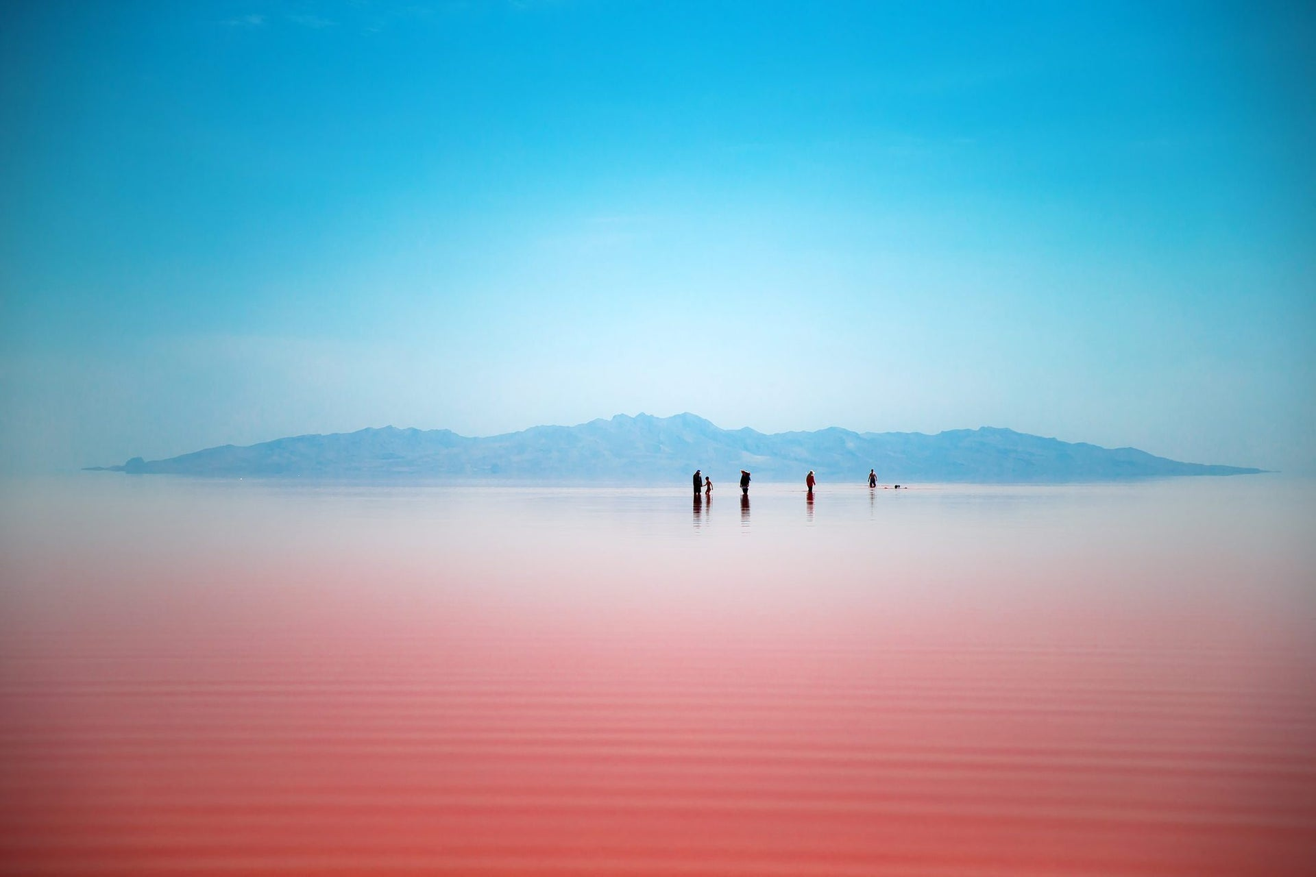 This picture taken on Friday, Aug. 26, 2016, shows Iranians spending time in Urmia Lake near Urmia, North-western Iran. Hopes for survival of Urmia salt lake have been revived after more rains boosted a government program aimed at preserving the almost dried up water body.