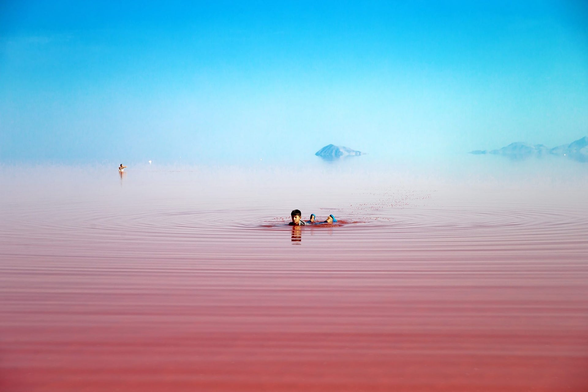 This picture taken on Friday, Aug. 26, 2016, shows an Iranian swimming in Urmia Lake near Urmia, northwestern Iran. Hopes for survival of Urmia salt lake have been revived after more rains boosted a government program aimed at preserving the almost dried up water body.