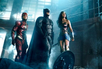 """Ezra Miller, left, Ben Affleck and Gal Gadot in a scene from """"Justice League."""""""