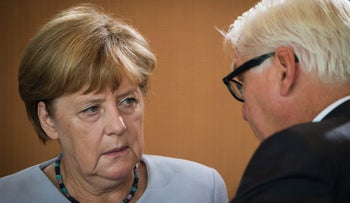German Chancellor Angela Merkel and foreign minister Frank-Walter Steinmeier at the weekly cabinet meeting in Berlin on August 31, 2016.
