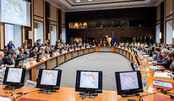 Members of the Global Coalition to Counter ISIL (ISIS) attend an anti-ISIL meeting at the Egmont Palace, Brussels, November 4, 2015.