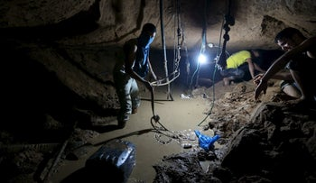 Palestinians work to repair a smuggling tunnel, that was flooded by Egyptian security forces, beneath the border between Egypt and southern Gaza Strip, November 26, 2015.