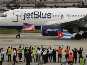 Workers and officials watch as JetBlue Flight 387 prepares for take off as it becomes the first scheduled commercial flight to Cuba since 1961, Fort Lauderdale, Florida, August 31, 2016.