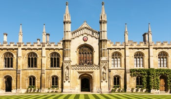 Exterior of Inner Court College with striped lawn in foreground, Cambridge University, England.