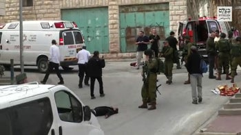 Scene from a video released on March 24, 2016 by B'Tselem showing IDF Sgt. Elor Azaria  aiming his weapon before shooting in the head and killing a wounded Palestinian assailant in Hebron.