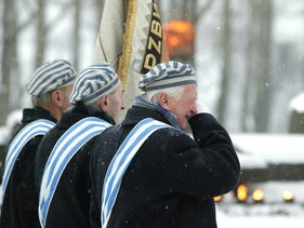 A concentration camp survivor wipes his tears during a ceremony at the former death camp Auschwitz in Birkenau, January 27, 2005.