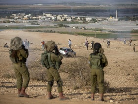 Israeli soldiers use tear gas to disperse Palestinians protesting against Israel settlements in the Jordan Valley, November 2016.