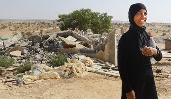 Raba Abu al-Kiyan, the widow of Yakub, next to the rubble of their home in Umm al-Hiran.