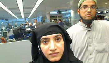 Syed Farook and his wife Tashfeen Malik going through customs in Chicago's O'Hare International Airport, December 7, 2015.