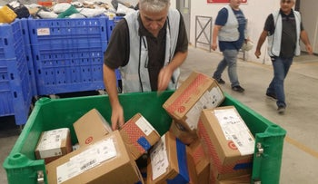 Sorting packages at an Israel Post facility.