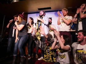 Fiddler on the Roof cast and audience members ring in Hanukkah at Hebro's HanuCon celebration in New York, December 6, 2015.
