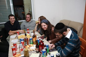 Michal Zernowitski (center) at a Hanukkah party in mid-December 2016 for members of the new Ultra-Orthodox division of Israel's Labor Party.