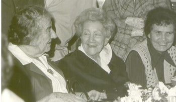 Irma Levy Lindheim, seated in middle, with Golda Meir, seated on left, and others. Photo taken at Kibbutz Mishmar Ha'emek.