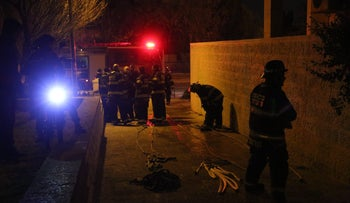 Firefighters on scene as murder–suicide suspected after woman, four children killed in Jerusalem apartment fire. January 1, 2017.
