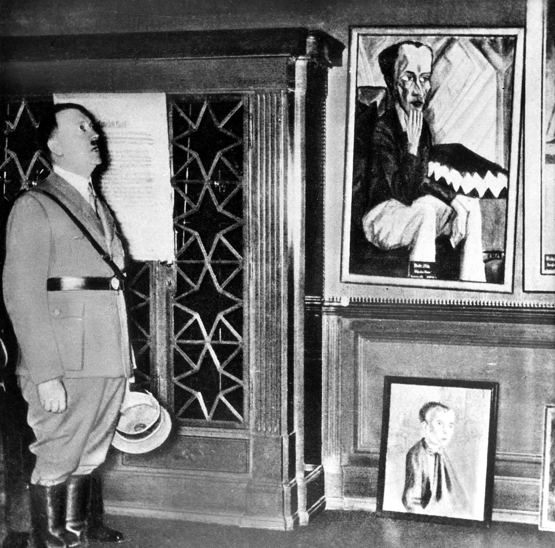 "Hitler surveying work by Erich Heckel and Ernst Grundig. The photo was featured in the film ""The Art that Hitler Hated."""
