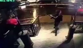 The attacker shooting his way inside the nightclub in Istanbul, early Sunday, January 1, 2017.