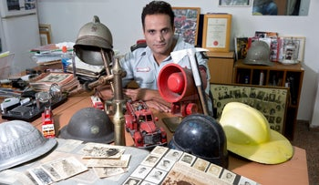 Lior Tehrani with a number of the items he has salvaged for posterity.