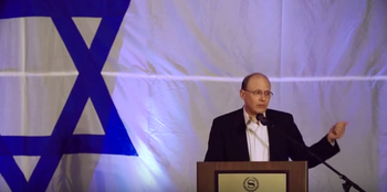 Screenshot of Kenneth Abramowitz speaking at an event in 2014.