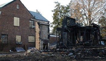 The remains of a structure burned by an arsonist in a Bukharian neighborhood in New York, December 7, 2015.