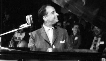 Victor Borge performing before an audience in 1957.