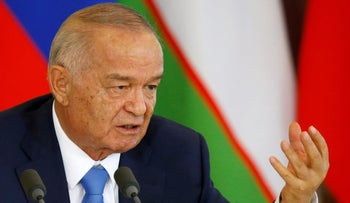 Uzbek President Islam Karimov speaks at a news conference at the Kremlin in Moscow on April 26, 2016.