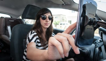 An Israeli using a driving app prior to a journey.